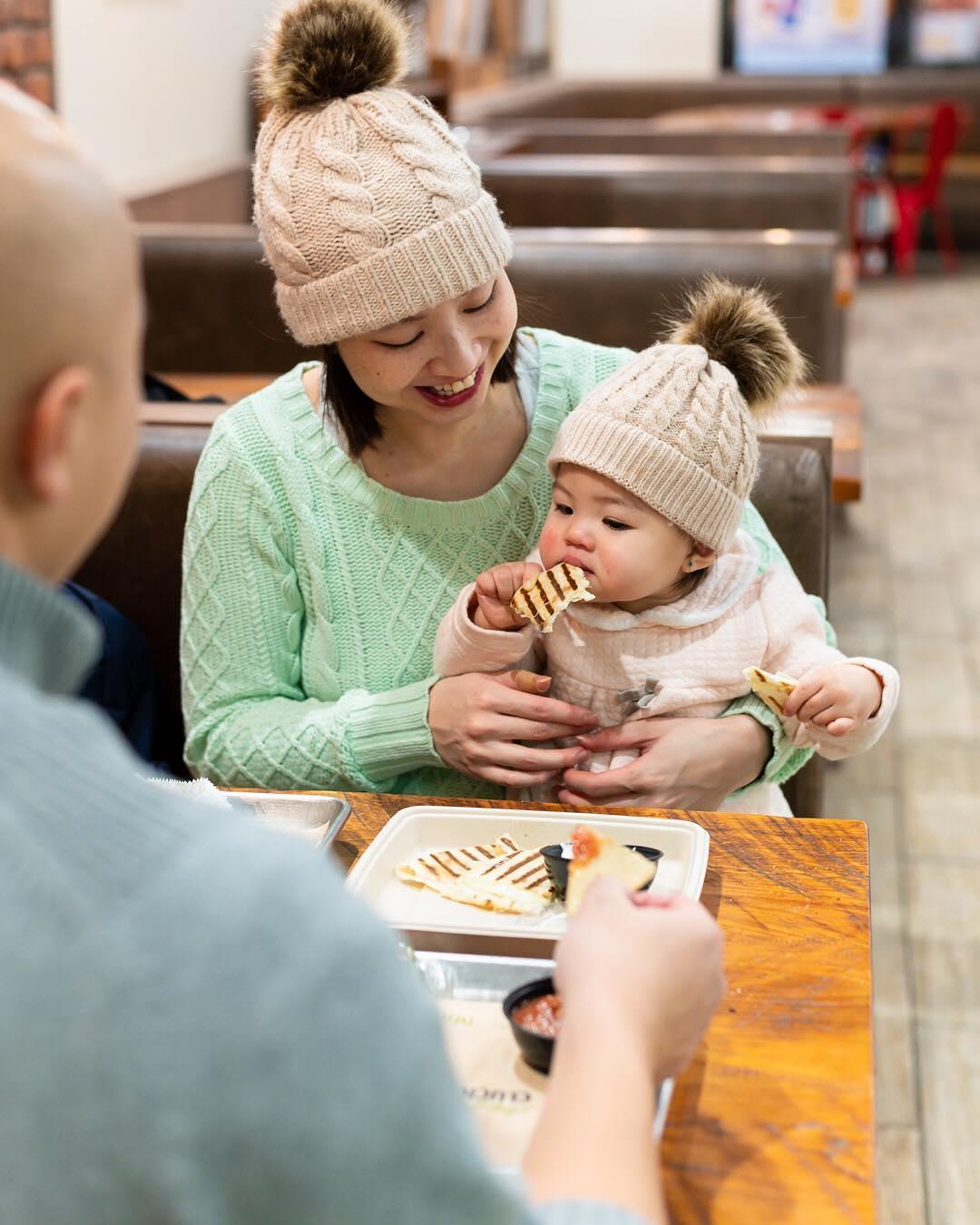 baby eats quesadilla from mucho burrito franchise